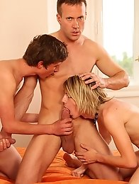 three hot guys arranged group sex on the bed